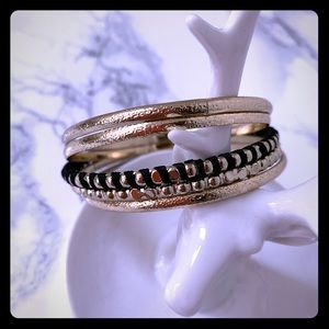 Gold and black colored bangle set